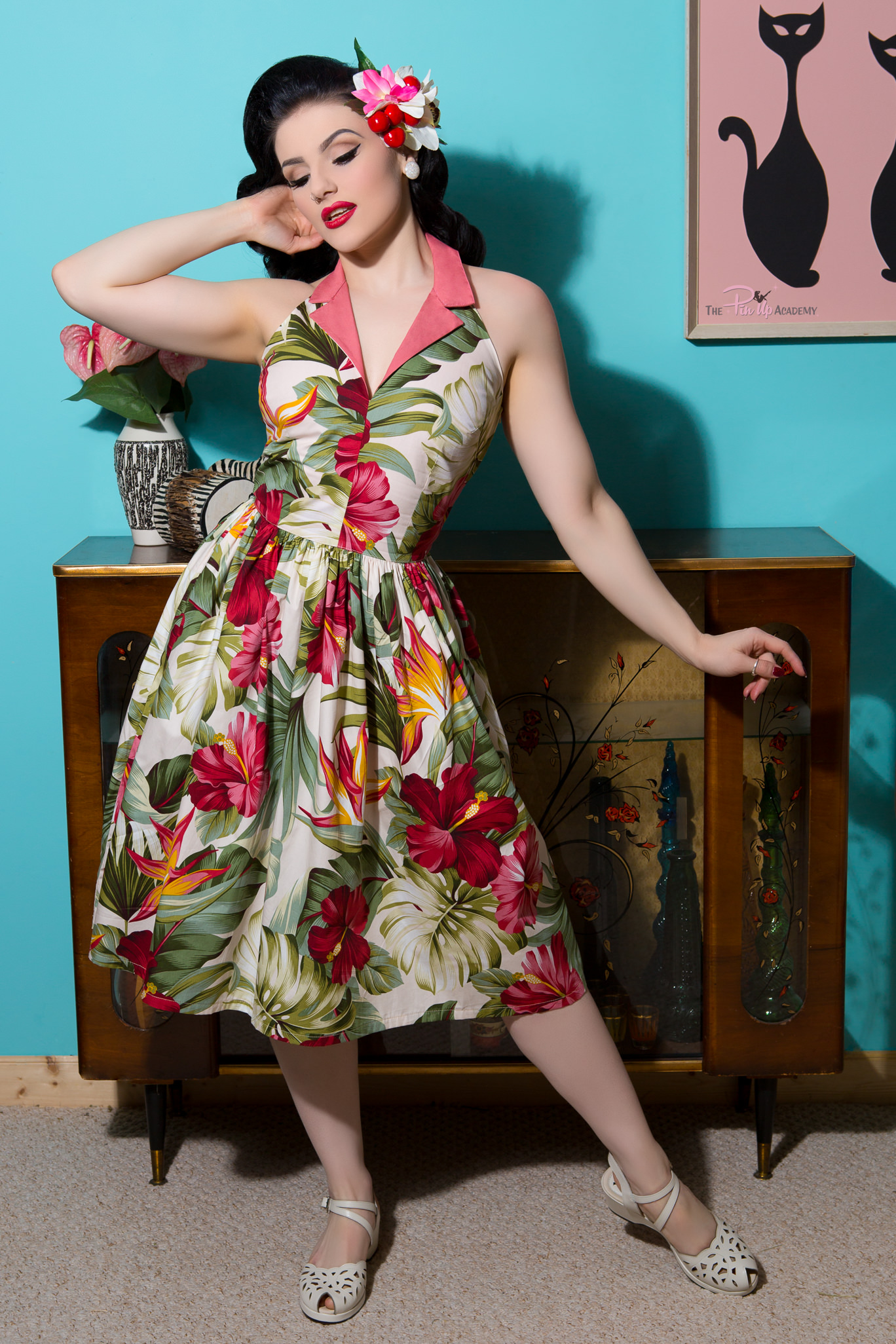 pinup model wearing floral vintage dress by violets in may