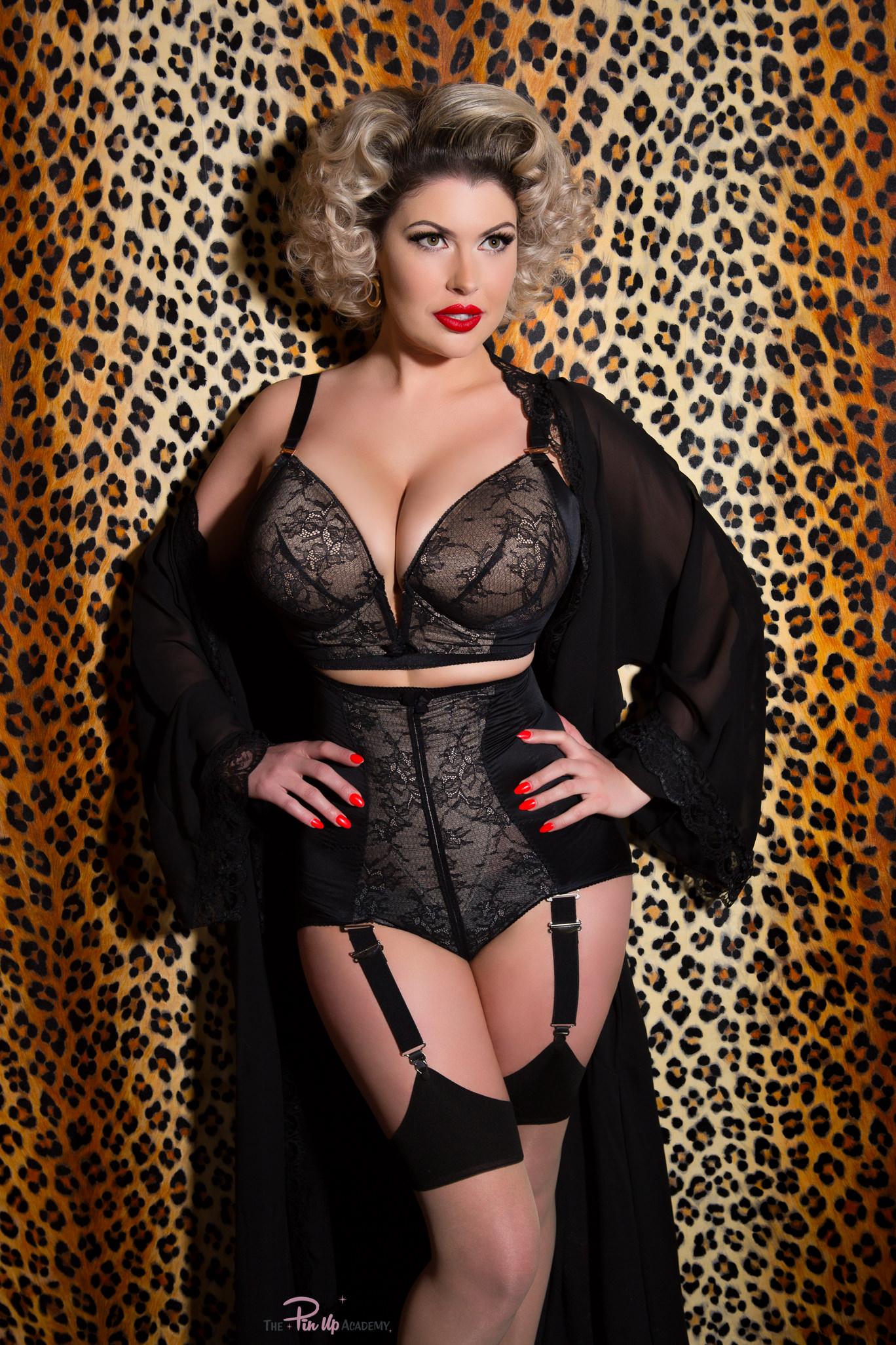 pinup girl wearing lingerie on leopard print background
