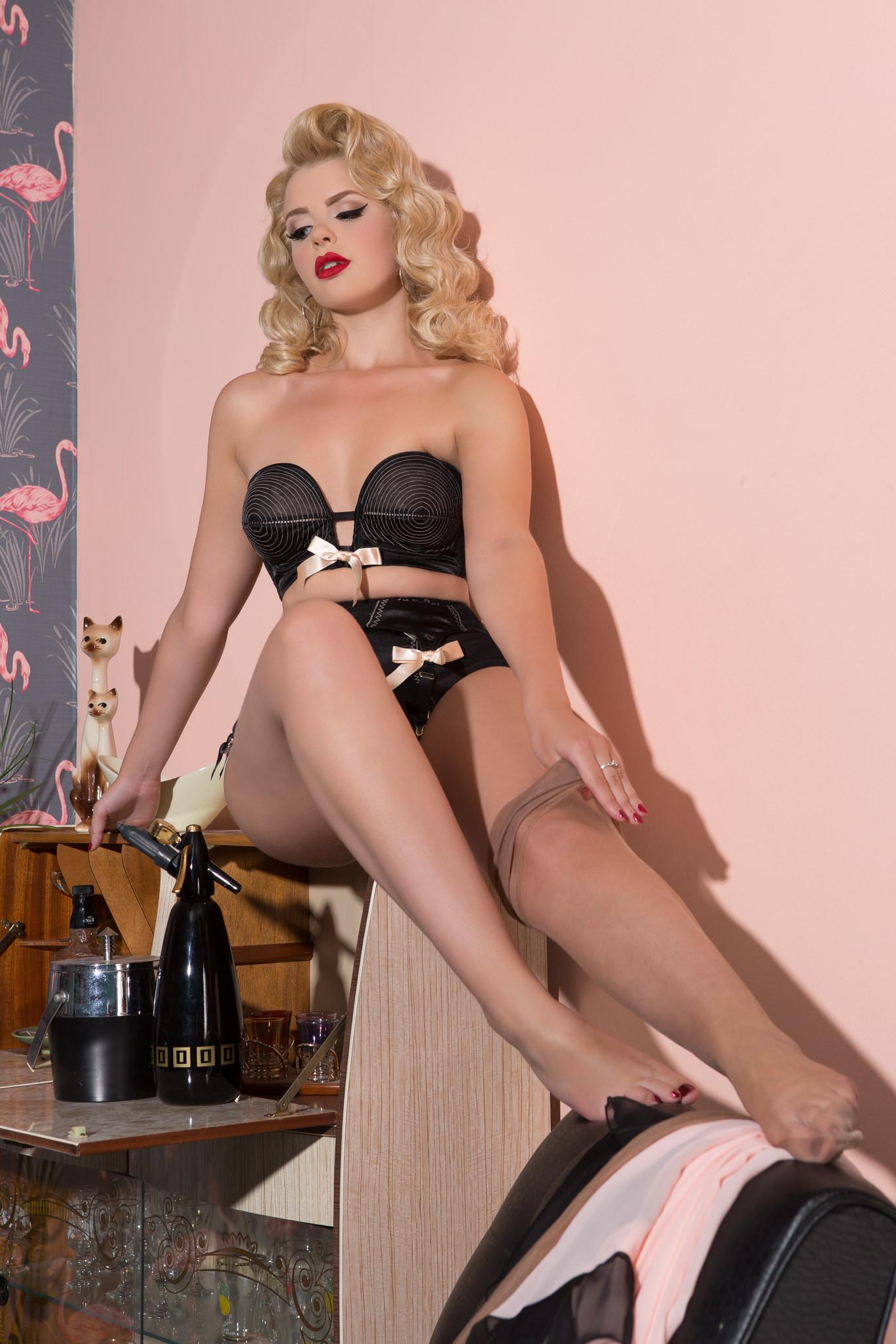 blonde pinup girl removing stockings